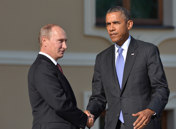 SAINT PETERSBURG - SEPTEMBER 05: In this handout image provided by Host Photo Agency, Russian President Vladimir Putin (L) and U.S. President Barack Obama shake hands during an official welcome during the G20 Summit on September 5, 2013 in St. Petersburg, Russia. The G20 summit is expected to be dominated by the issue of military action in Syria while issues surrounding the global economy, including tax avoidance by multinationals, will also be discussed during the two-day summit. (Photo by Alexey Kudenko/Host Photo Agency via Getty Images)