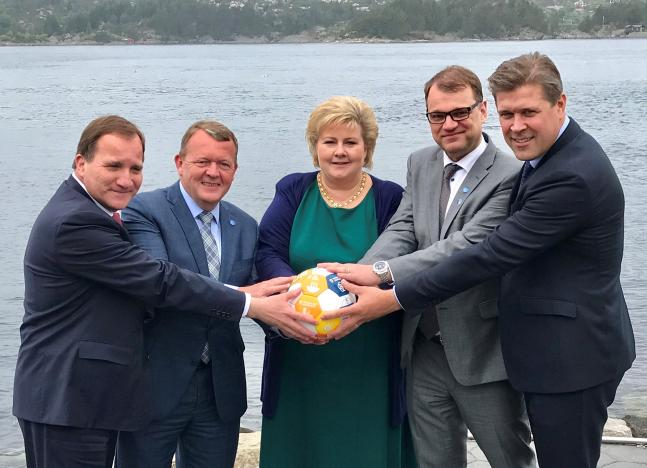 Sweden's PM Lofven with his counterparts Rasmussen of Denmark, Solberg of Norway, Sipila of Finland and Benediktsson of Iceland hold a soccer ball during their meeting in Bergen